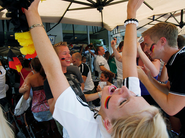 Fans celebrate celebrate a goal as they watch the World Cup quarterfinal soccer match between Argentina and Germany, Saturday, July 3, 2010, at a German restaurant in Miami Beach. Germany won 4-0. (AP Photo/Wilfredo Lee)