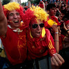 Fans react after Spain scored during the World Cup quarterfinal soccer match between Spain and Paraguay, on a large screen outside the Santiago Bernabeu stadium in Madrid, on Saturday, June 3, 2010.   Spain won 1-0. (AP Photo/Arturo Rodriguez)