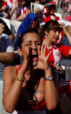 Larissa Riquelme, a fan of Paraguay's soccer team, cheers during a South Africa 2010 World Cup game between Paraguay and Spain at a public viewing of the match in Asuncion, Saturday July 3, 2010.  Spain won 1-0. (AP Photo/Jorge Saenz)