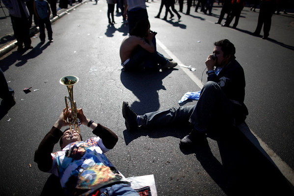 Fans of Argentina's soccer team react to the 4-0 loss to Germany in the South Africa 2010 World Cup quarterfinals, in Buenos Aires, Saturday July 3, 2010. (AP Photo/Natacha Pisarenko)
