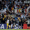 Germany players celebrate in front of their supporters at the end of the World Cup quarterfinal soccer match between Argentina and Germany at the Green Point stadium in Cape Town, South Africa, Saturday, July 3, 2010. Germany won 4-0. (AP Photo/Martin Meissner)