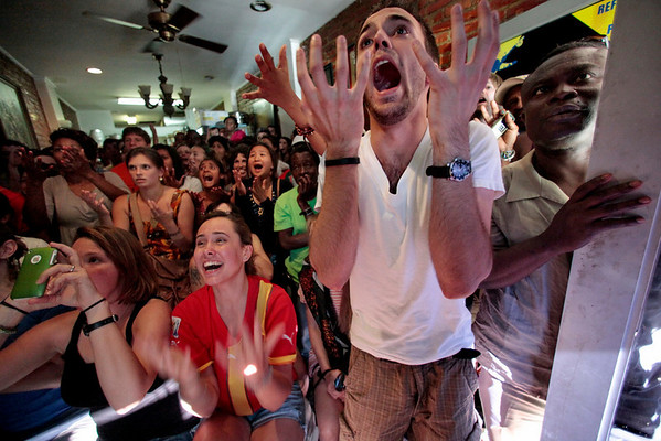 Fans of Ghana's World Cup soccer team react as they watch a broadcast of the final moments of  quarterfinal match play against Uruguay at MeyTex Ghanaian restaurant in the Brooklyn borough of New York on Friday July 2, 2010. Uruguay won in a penalty shootout 2-1 and advance to play the Netherlands.  (AP Photo/Bebeto Matthews)