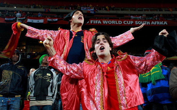 Spain supporters dressed as bullfighters wait for the World Cup quarterfinal soccer match between Paraguay and Spain at Ellis Park Stadium in Johannesburg, South Africa, Saturday, July 3, 2010.  (AP Photo/Eugene Hoshiko)