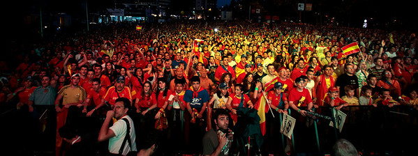 Fans react as they watch the World Cup quarterfinal soccer match between Spain and Paraguay, on a large screen outside the Santiago Bernabeu stadium in Madrid, on Saturday, July 3, 2010.  Spain won 1-0. (AP Photo/Arturo Rodriguez)