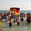 German fans celebrate in Arenales beach in Palma de Mallorca, Spain, after their team defeated Argentina on a World Cup quarterfinal match on Saturday, July 3, 2010. (AP Photo/Manu Mielniezuk)