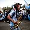 A fan of Argentina's soccer team plays a trumpet as he waits for the team's arrival after their elimination at the South Africa 2010 World Cup in Buenos Aires, Sunday July 4, 2010. (AP Photo/Natacha Pisarenko)