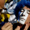An Argentine fan has his face painted in the colors of the national flag prior to the World Cup quarterfinal soccer match between Argentina and Germany at the Green Point stadium in Cape Town, South Africa, Saturday, July 3, 2010. (AP Photo/Julie Jacobson)