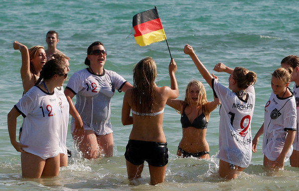 German soccer fans celebrate in Arenales beach in Palma de Mallorca, Spain, after their team defeated Argentina 4-0 in their World Cup quarterfinal match on Saturday, July 3, 2010. (AP Photo/Manu Mielniezuk)