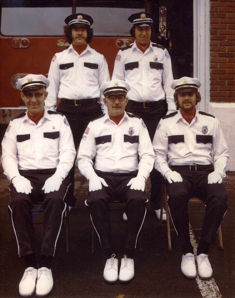 Photo of my uncle and his officers when my uncle was Chief. <br /> <br /> From left to right:<br /> 1st row: Doug Erwin, Richard Smith (My Uncle), Doug Moore<br /> 2nd row: Dennis Moore, Gary Mergler<br /> <br /> Photo by: Unknown photographer.
