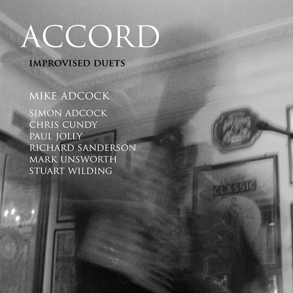 "Mike Adcock's design for the cover of this cd (and download) uses one of my photos of him playing the accordion in a live performance.  <a href=""https://linearobsessional.bandcamp.com/album/accord"">https://linearobsessional.bandcamp.com/album/accord</a>"