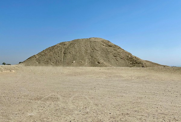 This mound is all that remains of the exterior of the Pyramid of Teti (2345–2323 BC), originally built in step form and cased in limestone.  Below ground the chambers and corridors are very well preserved.