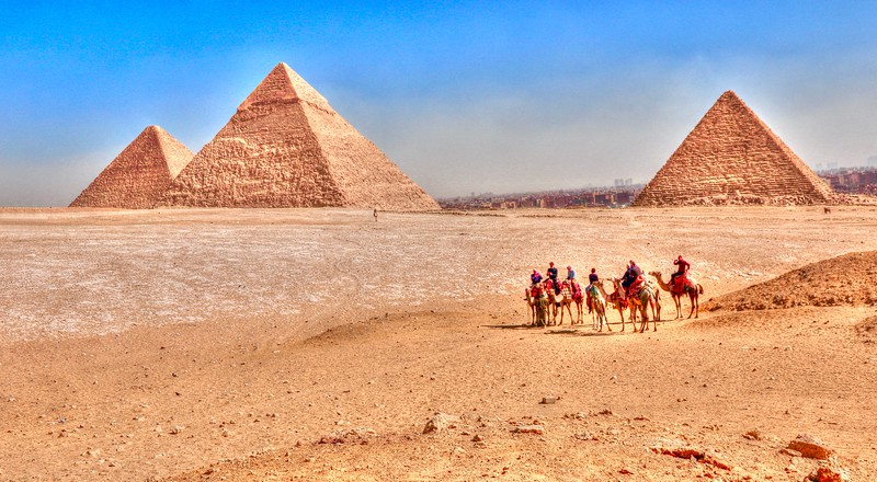 The Giza pyramid complex includes the Great Pyramid (Pyramid of Khufu- far left), the Pyramid of Khafre (center), and the Pyramid of Menkaure (far right)