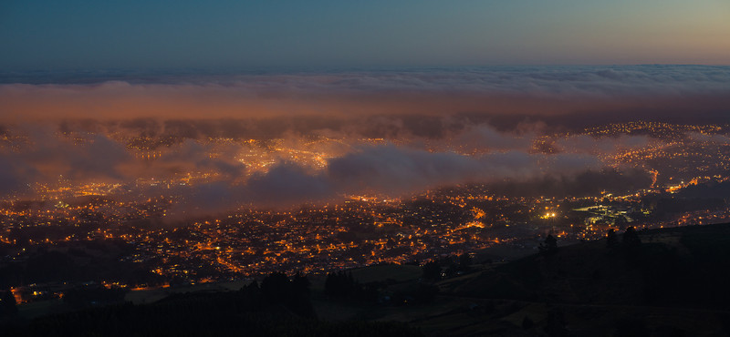 Dunedin by night, under a layer of fog