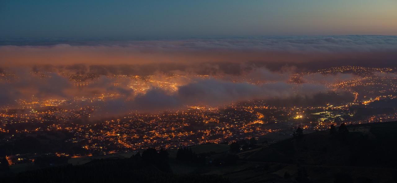 Dunedin by night, under a layer of fog