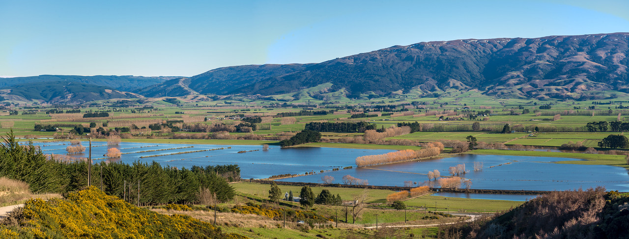 Flooded paddocks in the Taieri Plains. The Maungatua Range in the background