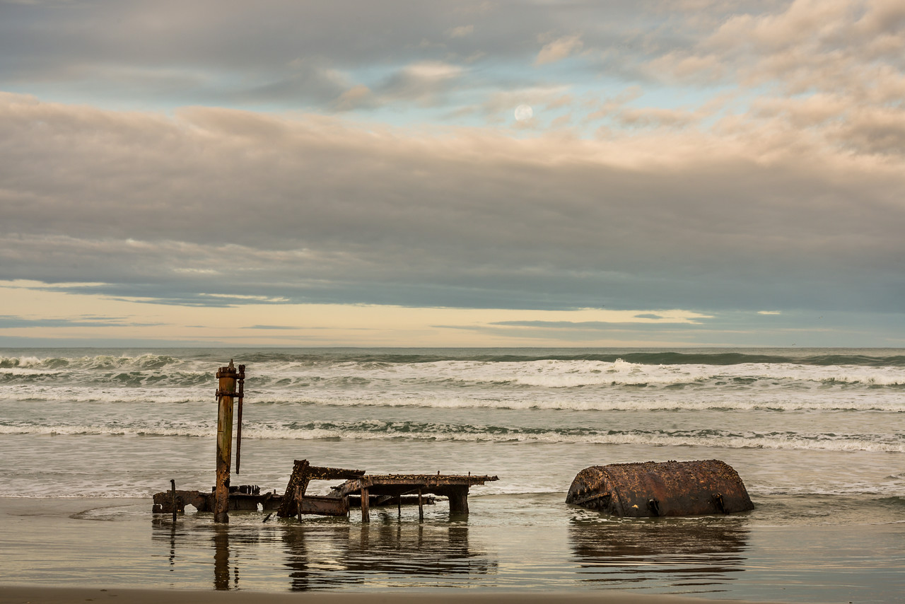 Supermoon above the shipwreck of the whaler Hananui II. Ryans Beach, Otago Peninsula