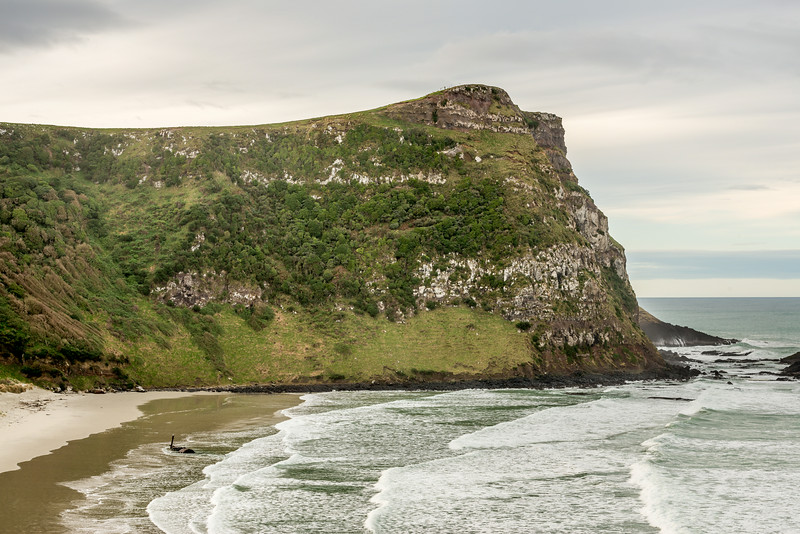 Ryans Beach and Quion Cliff. The shipwreck of the Hananui II is lapped by the waves