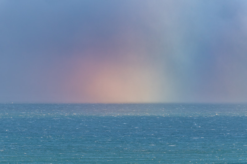 Rainbow off the coast at Heyward Point, Dunedin.