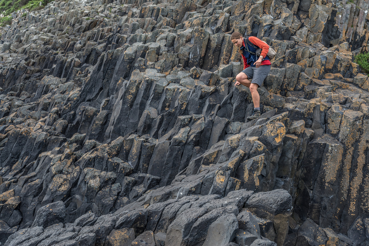 Moving on basalt columns at Black Head