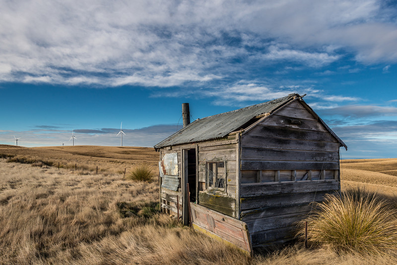 New meets old - wind turbines and a dilapidated hut