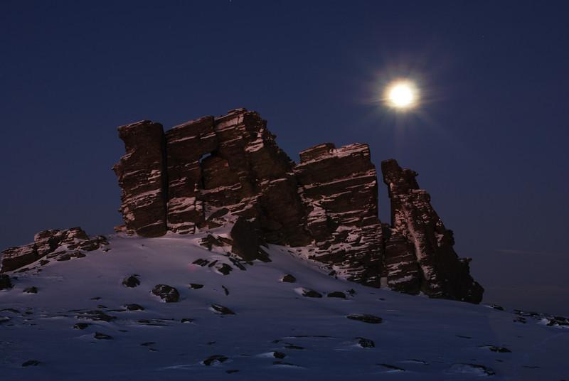 Setting moon over Stonehenge
