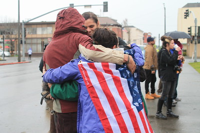 A group of friends embrace after the rally in front of the courthouse in Eureka.  (Natalya Estrada - The Times-Standard)