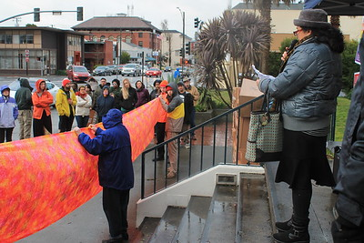 Renee Saucedo of Centro del Pueblo addresses the crowd on Friday morning about the new presidential administration at the Humboldt County Courthouse.  (Natalya Estrada - The Times-Standard)