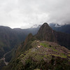 Northern facing view of Machu Picchu from the citadel's western corner of the Upper Agricultural Section . Urubamba River on left; Una Picchu in the left background;  Huayna Picchu in the mid background.<br /> <br /> Machu Picchu, Cusco Region, Urubamba Province, Peru.
