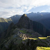 Sunrise View from the Upper Agricultural Section of Machu Picchu from the citadel's far southwestern corner. Urubamba River on left;  Huayna Picchu in the mid background. <br /> <br /> Machu Picchu, Cusco Region, Urubamba Province, Peru.