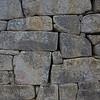 The Artisans' Wall, some of the Incan stonemason's finest stonework at Machu Picchu.<br /> <br /> Machu Picchu, Cusco Region, Urubamba Province, Peru.