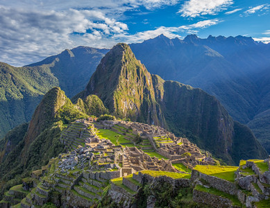 Sunrise view of Machu Picchu from near The Guardhouse located in the citadel's far southwestern corner.  Urubamba River on left. <br /> <br /> Machu Picchu, Cusco Region, Urubamba Province, Peru.