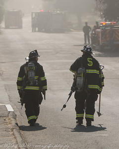 Salem Engine 2 walking through the smoke towrds the fire.
