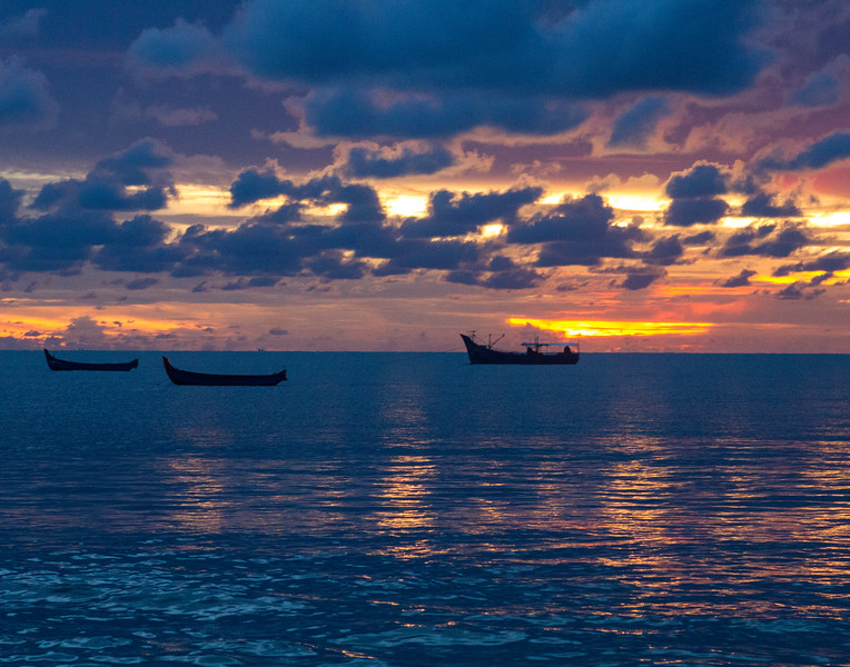 Brilliant Sunset and Boat Sihouettes. Mariari, India.