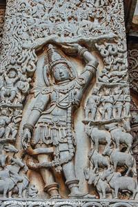 Krishna lifting Govardhan mountain, Hoysaleswara temple, Halebidu