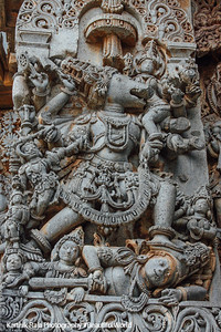 Vishnu with a head of a boar walking over a demon (Varaha), relief sculpture Hoysaleswara temple, Halebidu