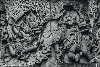 Indra riding an elephant, with Lakshmi seated on Garuda, Hoysaleswara temple, Halebidu