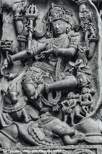 Shiva dancing on the head of a slain elephant (Gajasura) and holding its skin up behind his back, Hoysaleswara temple, Halebidu