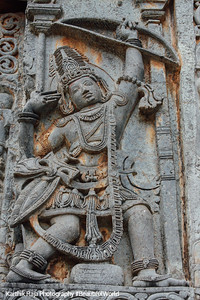 Arjuna, shooting an arrow, Hoysaleswara temple, Halebidu