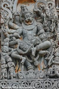 Vishnu with the head of a lion disemboweling Hiranyakashipu on his lap (Lakshminarasimha), Hoysaleswara temple, Halebidu