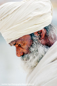 A man in contemplation, Golden Temple, Anritsar, Punjab, India