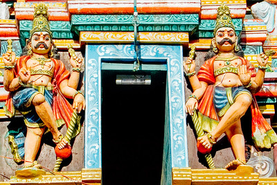 Dwarapalayas guarding the entrance, Pazhamudhircholai Temple, Madurai, India