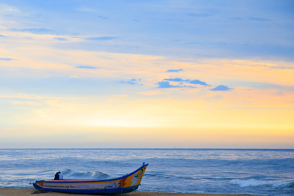 Lovers on a boat, Mahabalipuram Beach, India