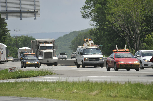 Car traffic moves along Route 22 in Ebensburg just before the July 4 holiday.
