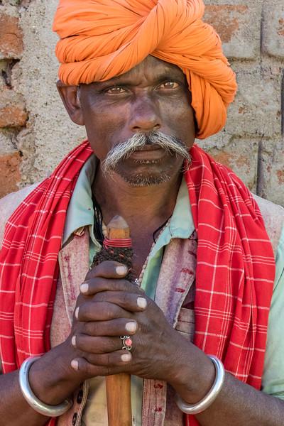 Chilpi, Bhoramdeo, Chhattisgarh, India. A Baiga man pauses against a market wall.