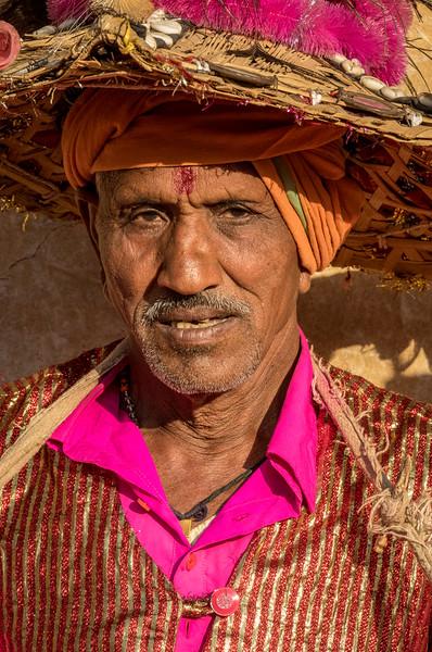 Lata, Bhoramdeo, Chhattisgarh, India. A muscian awaits the beginning of a tribal dance.