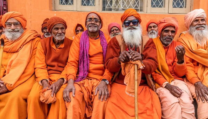 Haridwar, India. Geeta Ashram. A jovial group of sadhus in the dinner line.