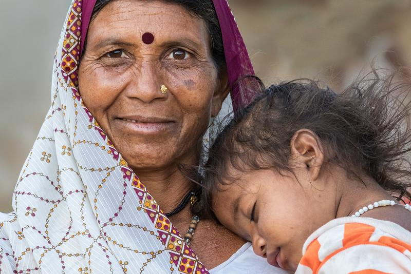 Lata, Bhoramdeo, Chhattisgarh, India. A village woman and her child.