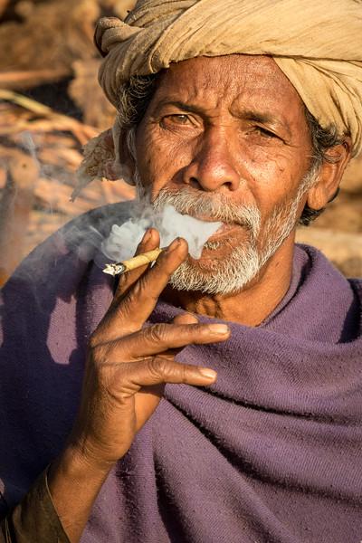 Benda, Bhoramdeo, Chhattisgarh, India. A Baiga man enjoys a morning smoke.