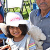 Enjoying the India Day Celebration is Naresh Shah of Lowell with his grandaughter Eva Dalia 4 1/2 also of Lowell. SUN/David H. Brow