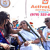 Program Director of Active Life Adult Day Care of Dracut, Jigna Patel , speaks with two of the clients, Privadan Shah  80 and Sulochana Shah 85, they are portraying the Ghandiji's at the India Day Celebration. SUN/David H. Brow